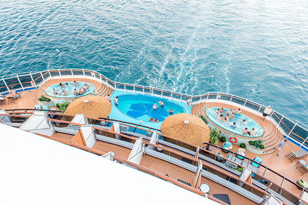 Aerial view of passengers enjoying the Havana Pool and hot tubs on Carnival Vista