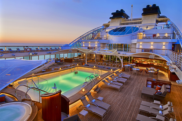 The Seabourn Encore pool deck at sunset