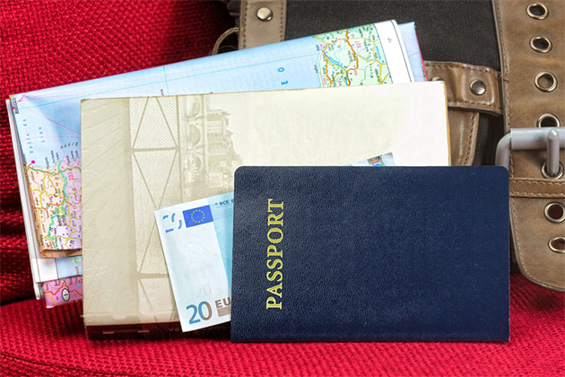 Close up of a traveling documents- passport, ticket, map and money