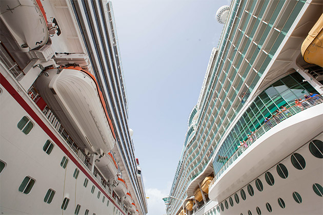 Shot of the pier between two large cruise liners in St. Maarten