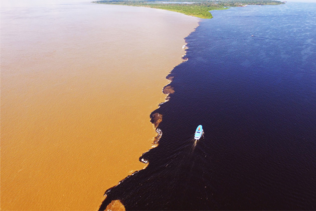 Aerial shot of the Meeting of the Waters in Brazil