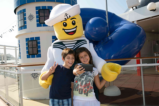 Two kids taking a selfie with a Lego character on MSC Cruises