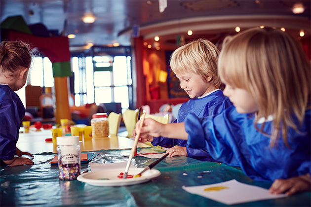 Two small children doing arts and crafts on a P&O cruise ship