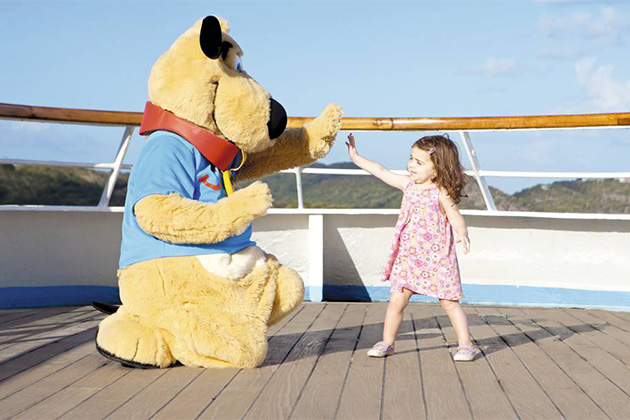 Child passenger high-fiving Thomson Cruises' mascot