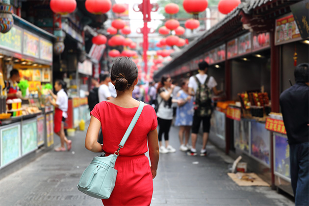 Woman wandering in Chinese food market