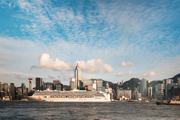 Two Cruises passing through the busy Victoria Harbor