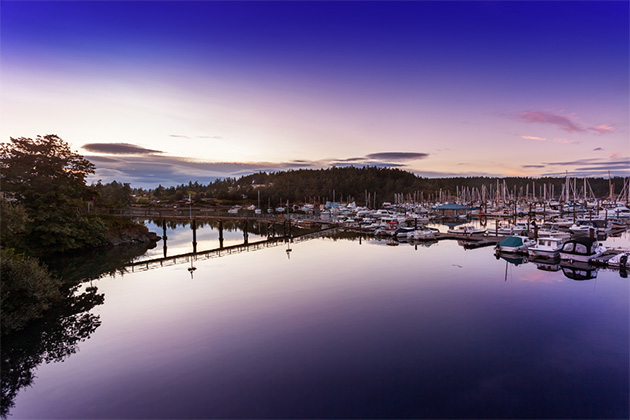 The waters in Friday Harbor's marina are still just after sunset in San Juan Islands, Washington