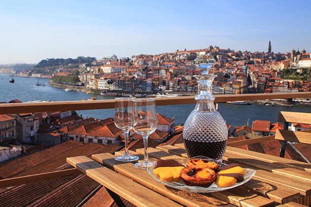 Table with a view of the river in Porto, Portugal