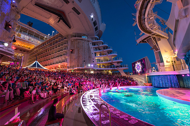 The AquaTheater on Oasis of the Seas during a nighttime performance
