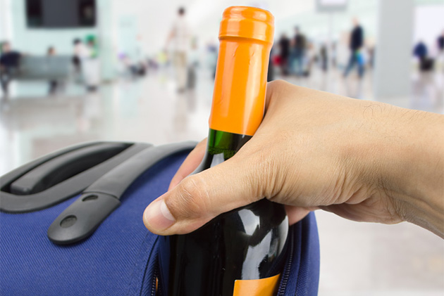 Wine bottle in suitcase