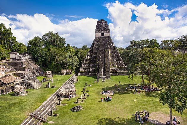 Tourists at the Gran Plaza at the archaeological site Tikal, Guatemala