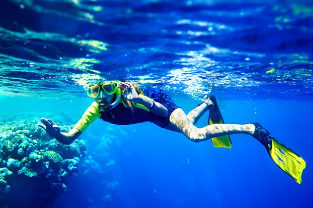 A kid scuba diving
