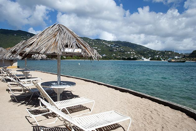 Empty beach chairs in front of Lindbergh Bay on St. Thomas