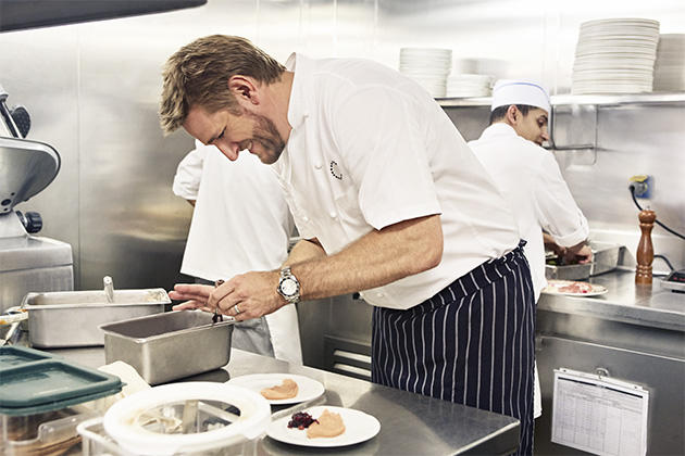 Action shot of Curtis Stone cooking