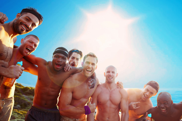 Eight shirtless men on rocky bluff