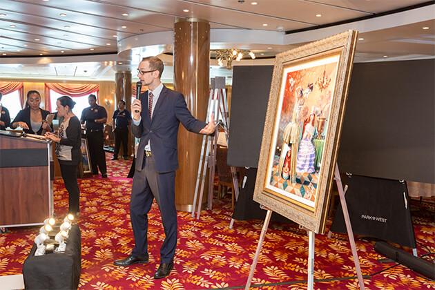 Park West employee holding an art auction on Norwegian Sun