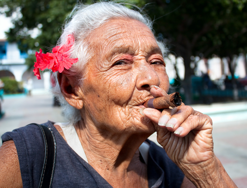 Old woman smoking cigar in Cuba