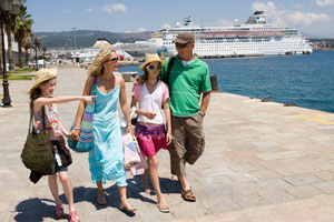family at a port near cruise ship