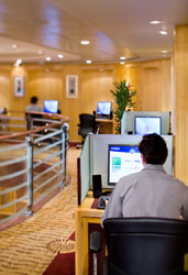 man at a cruise ship internet cafe