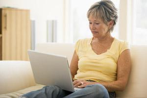 woman laptop sofa research online