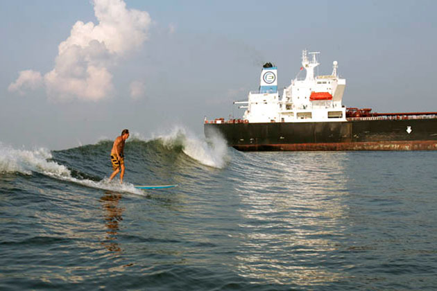 surfing the waves caused by tankers
