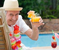 Pool side enjoying a drink - photo courtesy of wavebreakmedia/Shutterstock