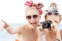 Friends taking a picture - photo courtesy of Nikkolia/Shutterstock