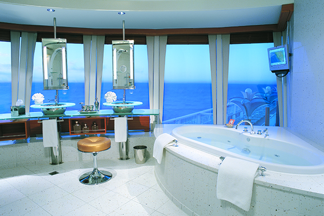 The Three-Bedroom Garden Villa bathroom onboard Norwegian Star.