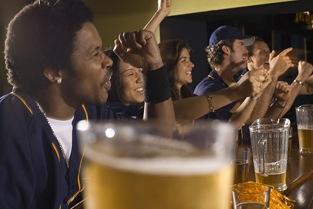 People cheering with beer at a bar