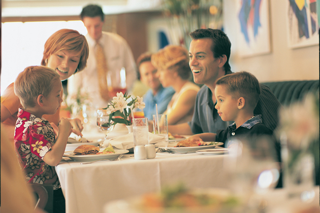 family dining on a cruise ship