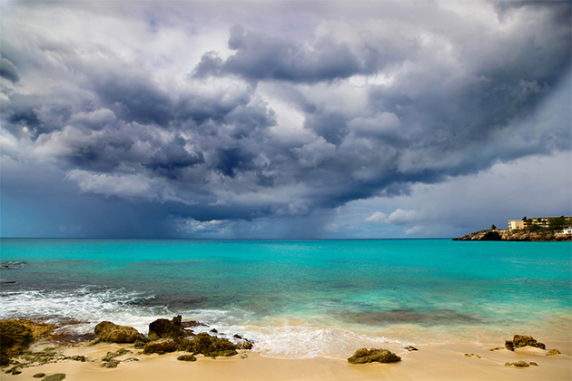 Rocky beach with storm clouds in the sky