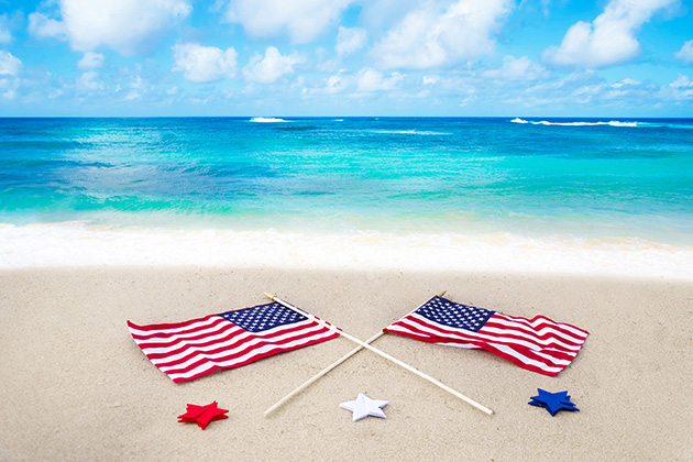 American flags laid out on a beach