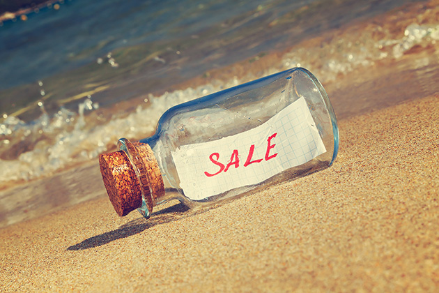 message in a bottle reading the word sale