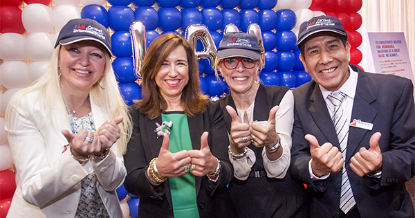 Christine celebrating with the 2014 'I AM Carnival' Award Winners at an award ceremony at Carnival's Doral Headquarters last May