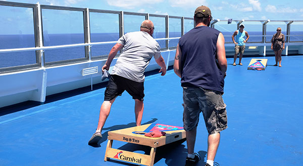 Passengers playing Valor's bean bag toss