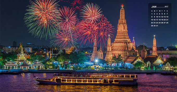 Wat arun and cruise ship in night time under new year celebration, Bangkok city ,Thailand