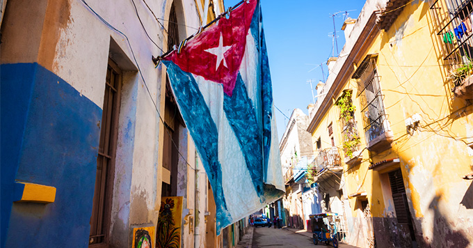 Cuban flag hanging from the side of a building in Havana