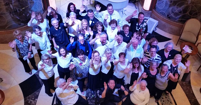 A happy choir crowd in the Grand Princess Atrium