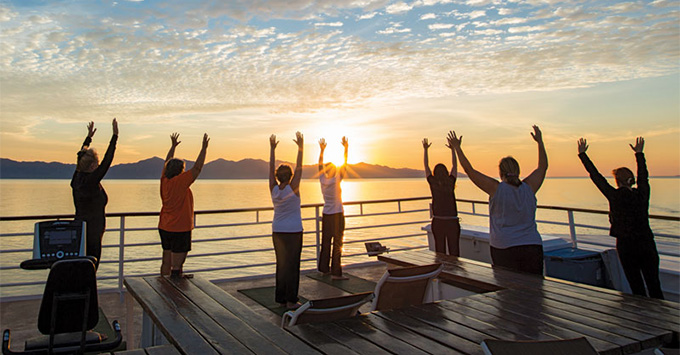 Top-deck yoga on an UnCruise Alaska itinerary