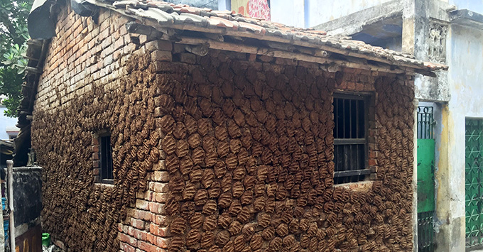 Cow dung-covered building in an Indian village