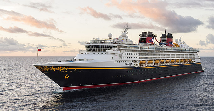 Exterior shot of Disney Magic at sea during sunset