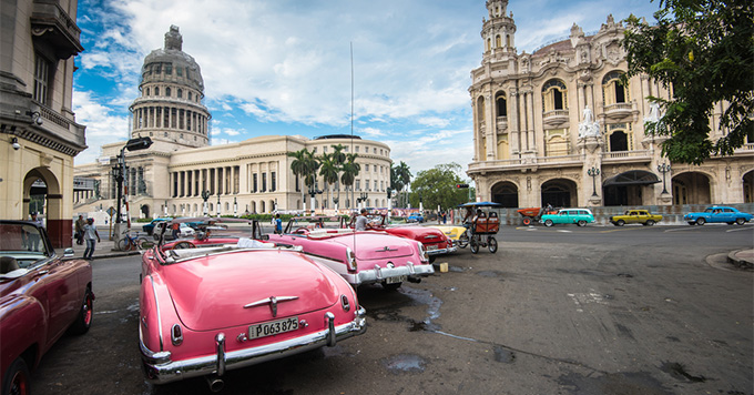Classic american car and Capitolio landmark in Havana,Cuba. Havana is tourist most popular destination in whole Cuba island.