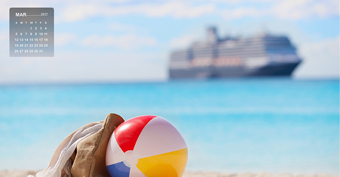 view of beach ball and beach bag at the sand with cruise ship in the background