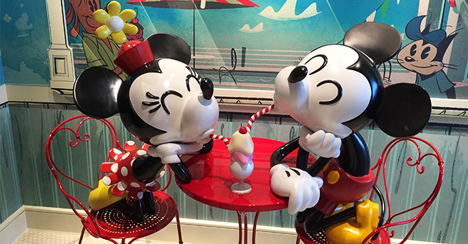 Mickey and Minnie statues sharing a milkshake outside of Sweet on You on Disney Fantasy