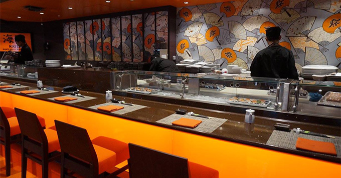 A sushi bar can be found along the promenade's top deck.