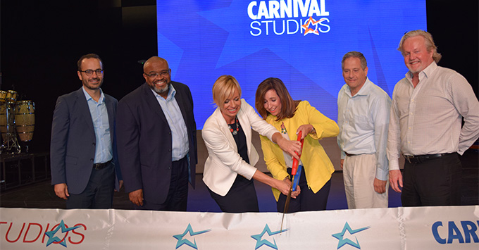 Carnival executives cutting the ribbon at the unveiling of Carnival Studios in Florida