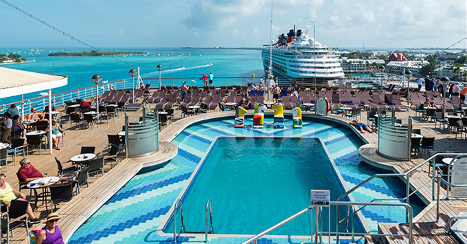 View of a Disney cruise ship in the Caribbean from the vantage point of Oosterdam's pool deck