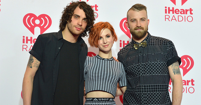 Members of the rock band Paramore attends the 2014 iHeartRadio Music Festival