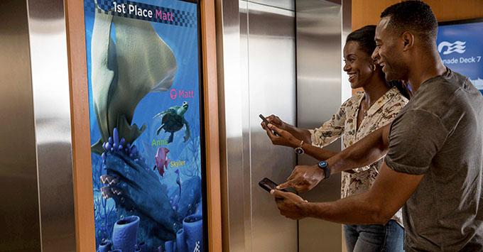 Guests playing Tagalong Sprint at elevator bank