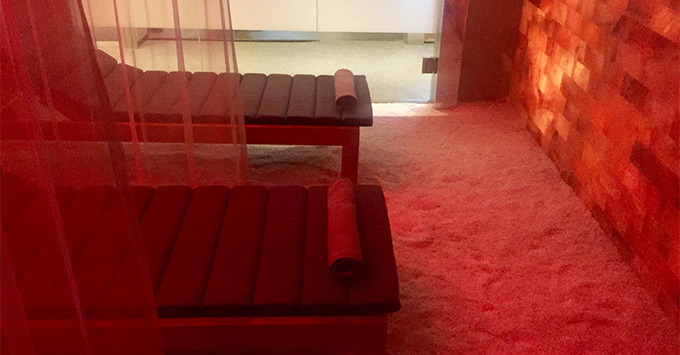 Red-lit salt room and two spa loungers